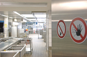 Restaurant kitchen with food safety signs